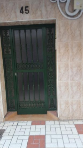 Exterior entrance door with bars