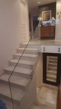 Glass stair railing.